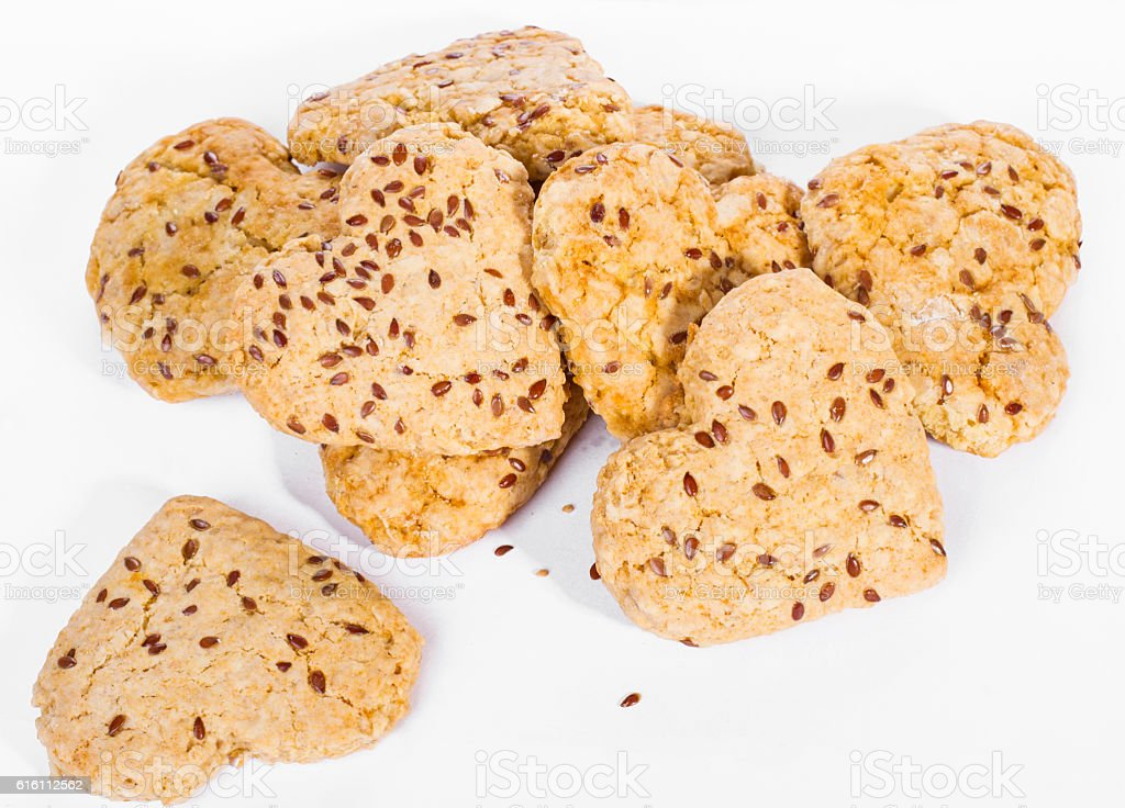 homemade cookies with flax seed on white background stock photo