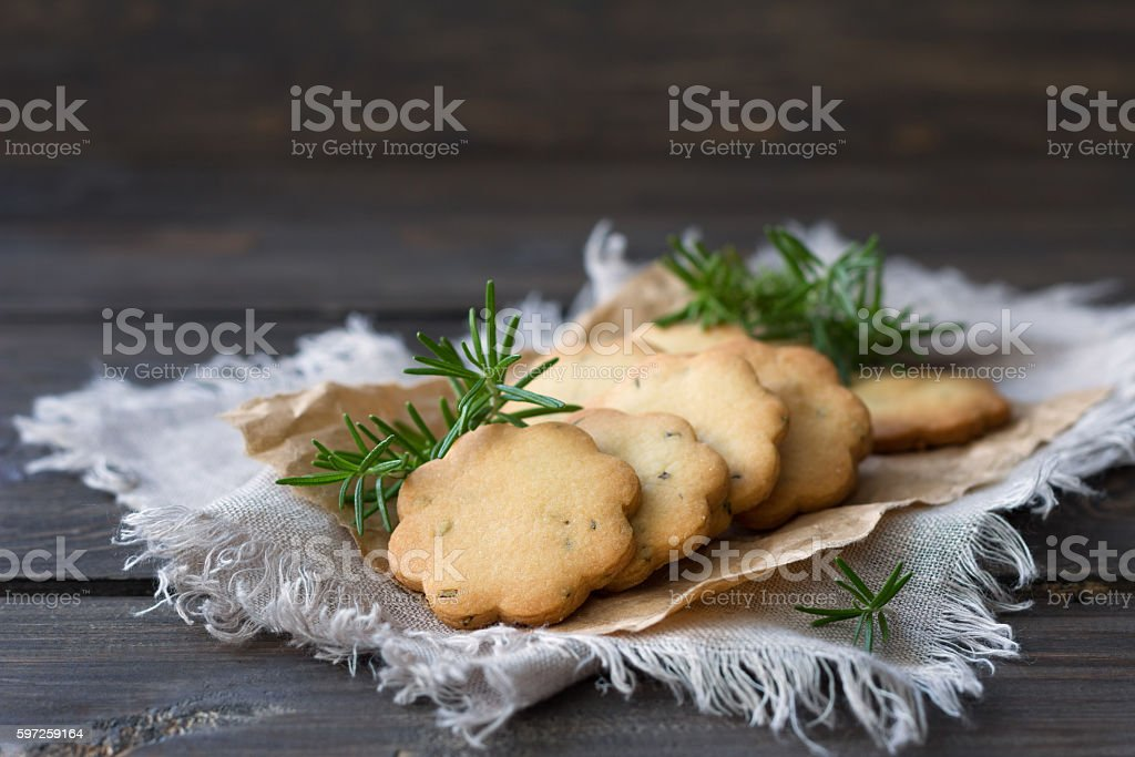 Homemade cookies with rosemary on a wooden surface stock photo