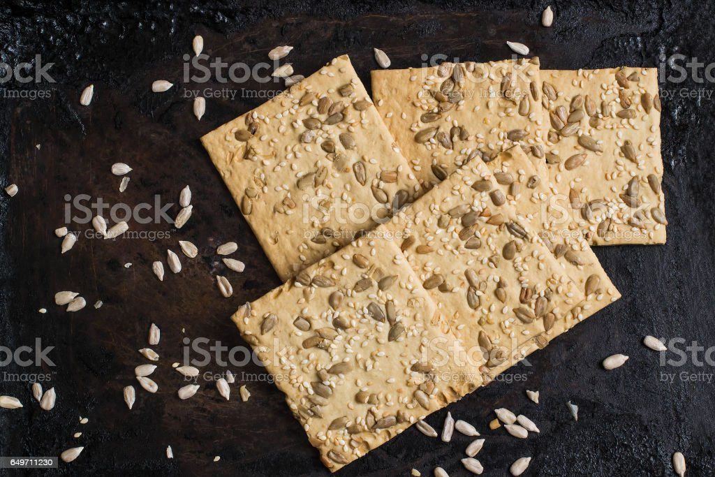 Homemade crackers with sunflower seeds and sesame stock photo