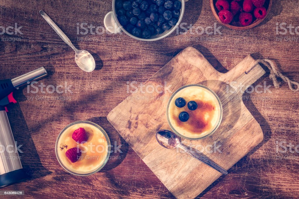 Homemade Creme Brulee with Berries stock photo