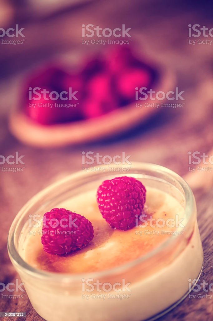 Homemade Creme Brulee with Raspberries stock photo