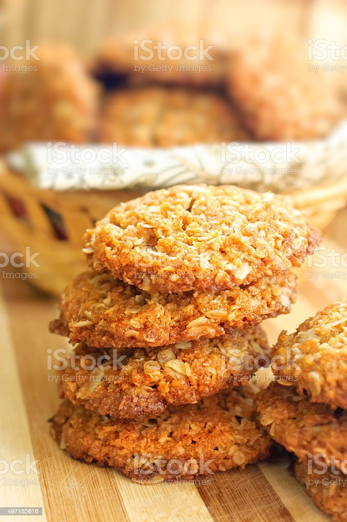 Homemade crispy cereal cookies on rustic wooden board. stock photo