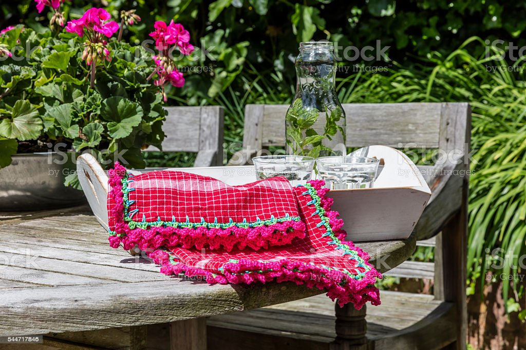 Homemade Crochet Dish Towel On A Tray In The Garden stock photo
