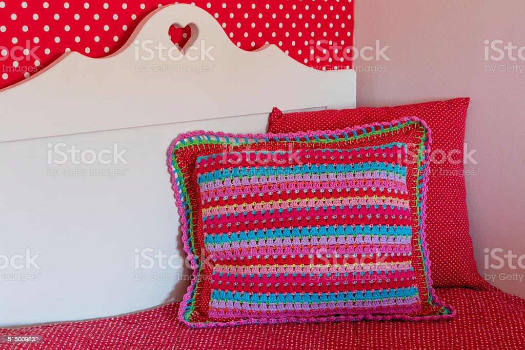 Homemade Crochet Pillow On Little Girl's Bed stock photo