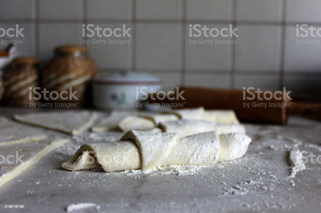 Homemade croissants on the flour dusted surface stock photo