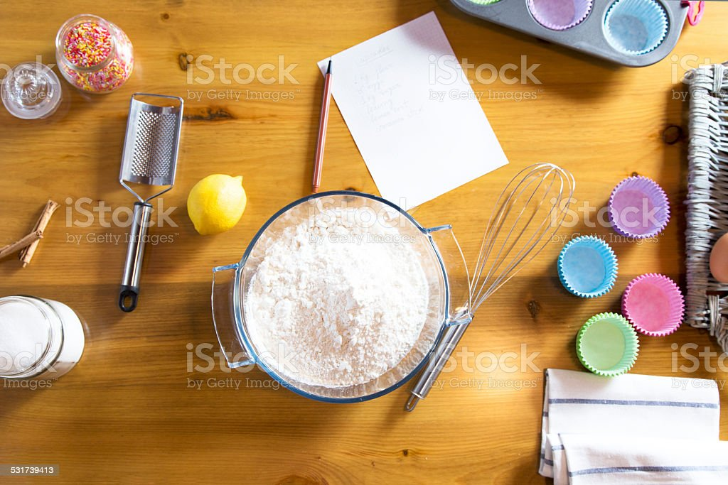 Homemade cupcakes dough preparation with ingredients and utensils stock photo