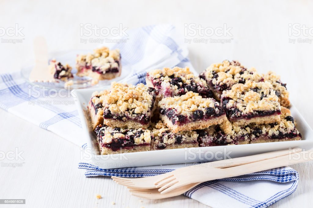 Homemade currant cornmeal crumble bars with streusel topping stock photo
