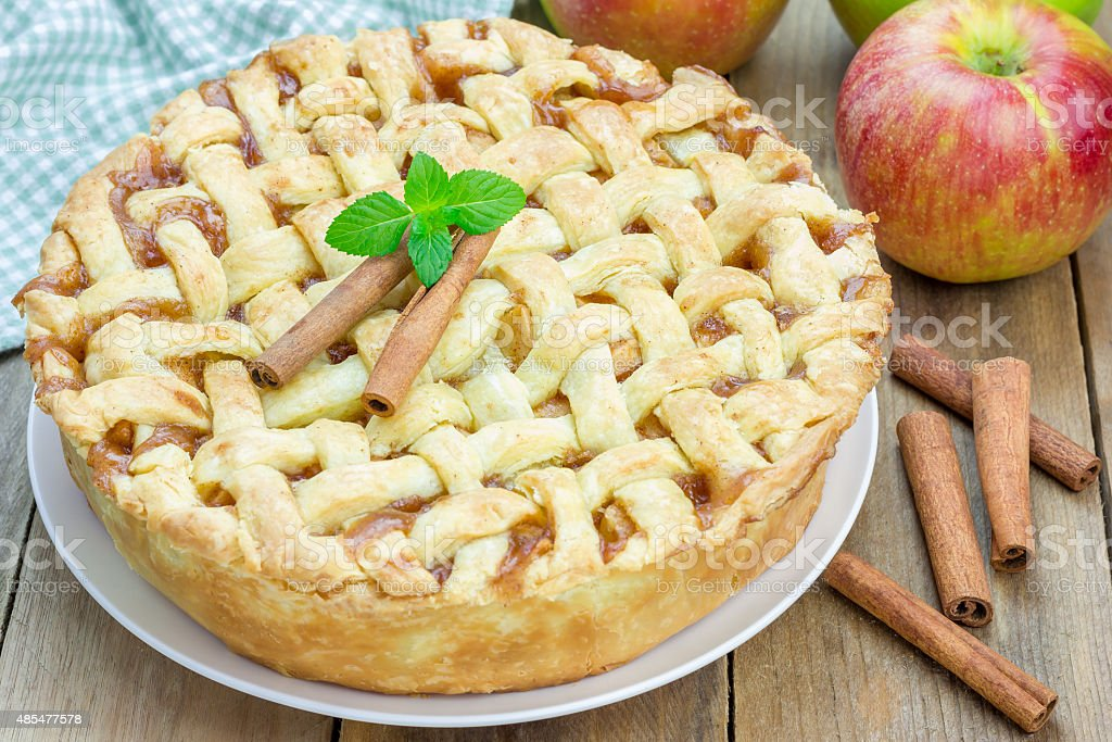 Homemade delicious apple pie with lattice pattern stock photo