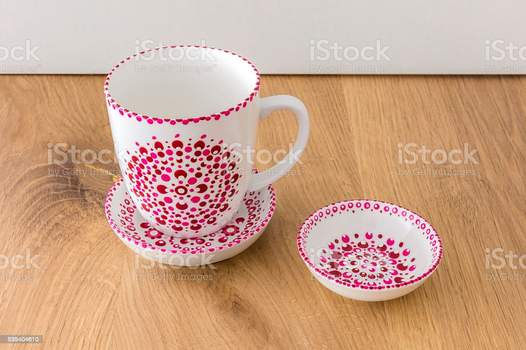 Homemade Dotted Porcelain Cup, Plate And Bowl stock photo
