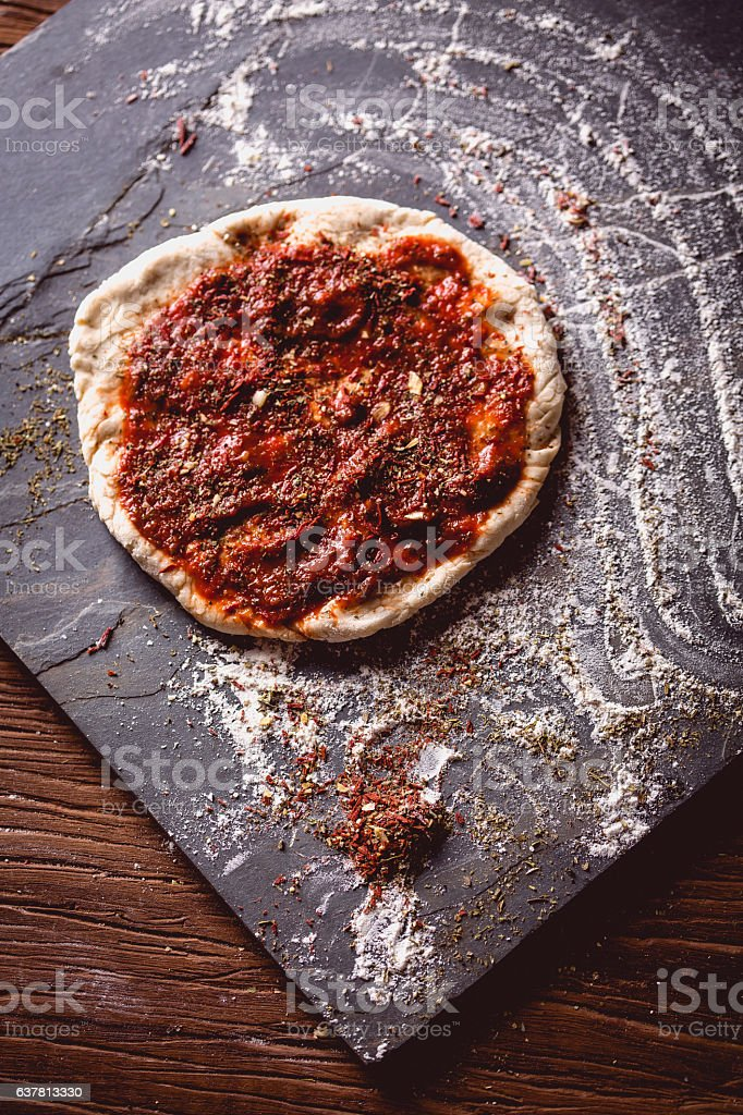 Homemade dough, preparing natural pizza on wooden table stock photo