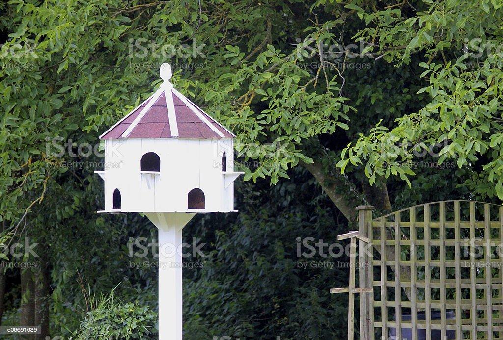 Homemade dovecote birdhouse image in garden, white dovecot on post royalty-free stock photo