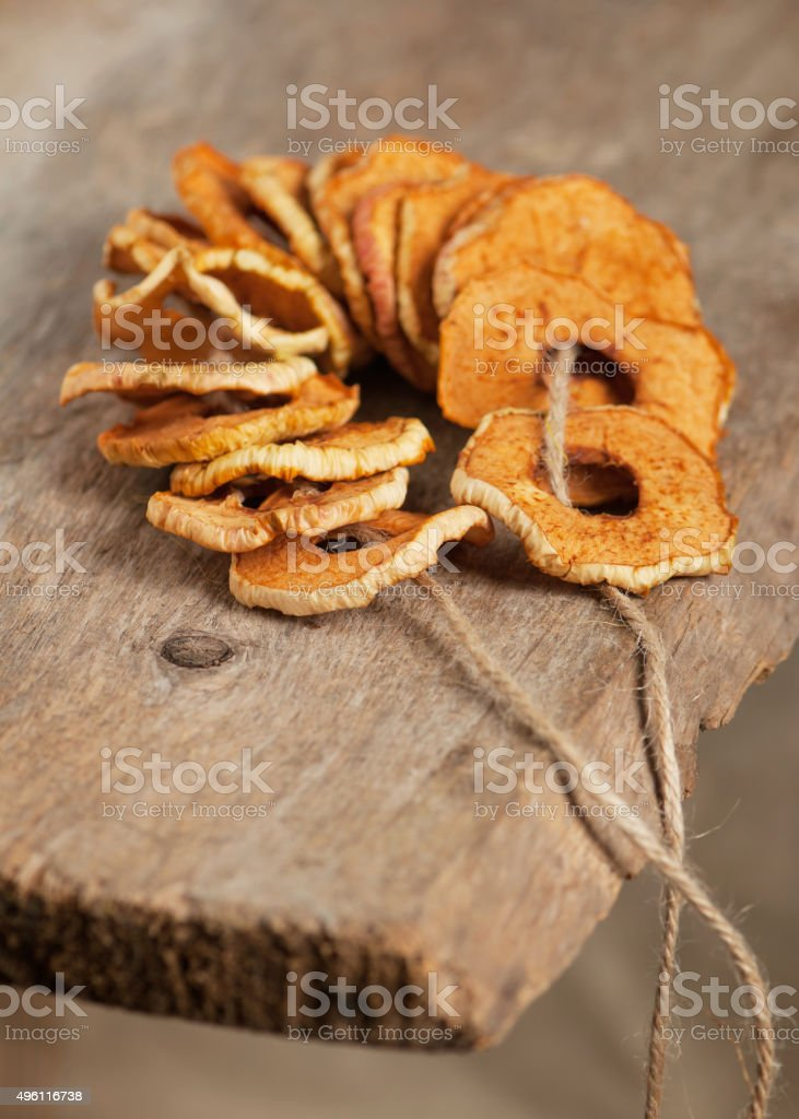 Homemade dried apple rings on bit of string. stock photo
