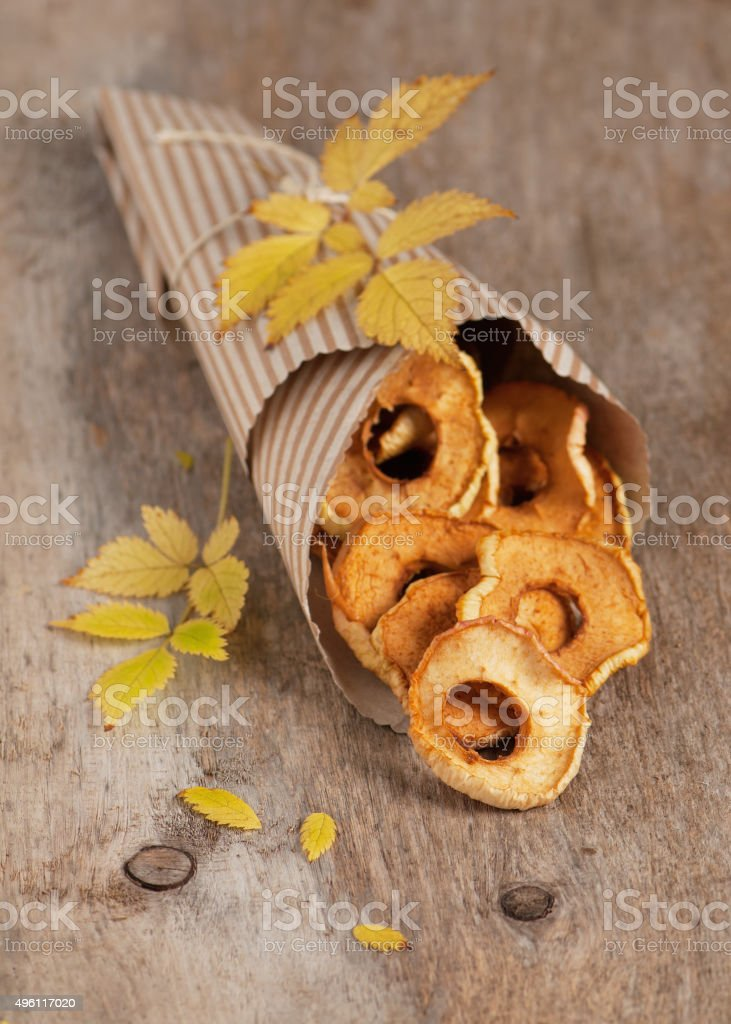 Homemade dried apple rings split out of paper bag. stock photo