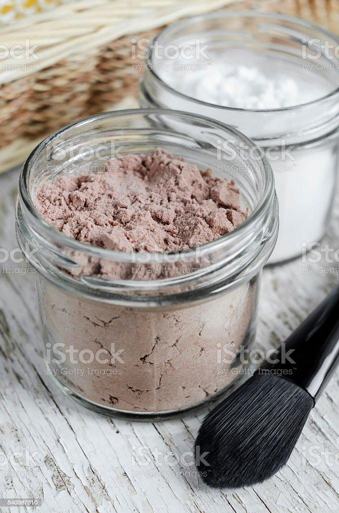 Homemade dry shampoo in a glass jar stock photo