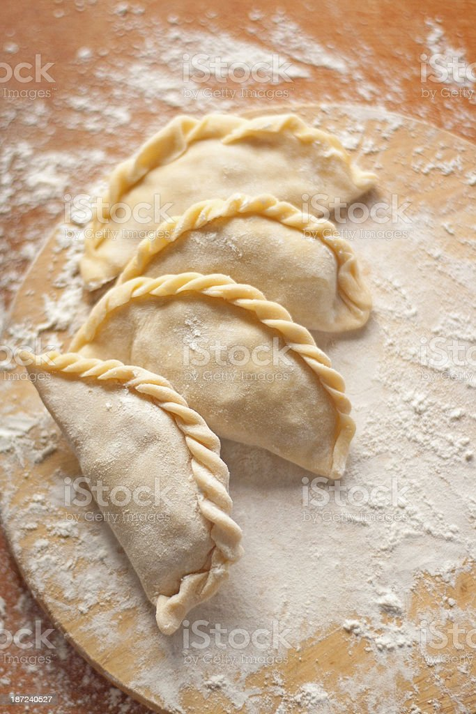 Homemade dumplings with potato on a wooden board stock photo