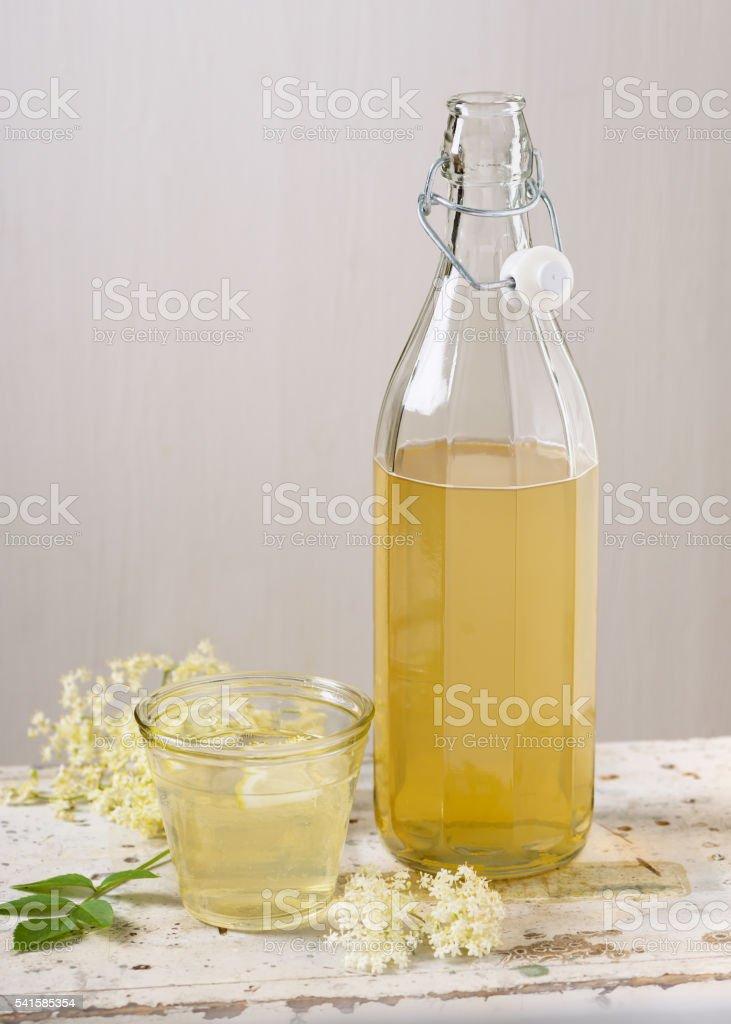 Homemade elderflower syrup in a bottle. stock photo