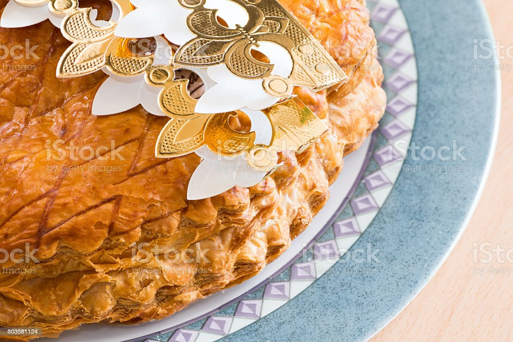 Homemade Epiphany King's cake pastry with gold crown stock photo