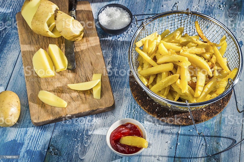 Homemade French fries made from potatoes royalty-free stock photo