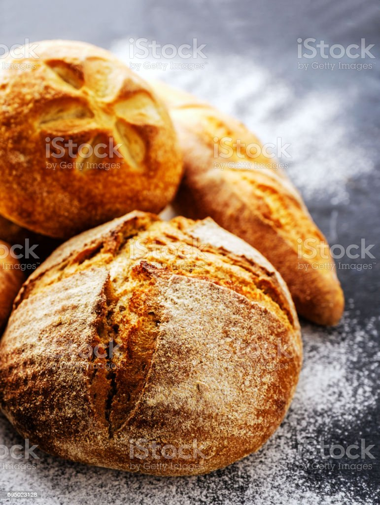 Homemade fresh bread on the dark table stock photo