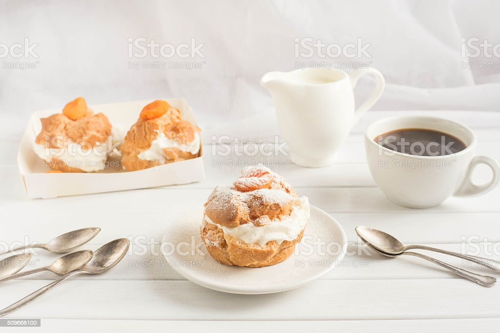 Homemade fresh cream puff with whipped cream and apricots. stock photo