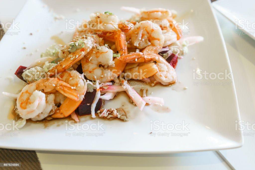 Homemade fresh shrimp salad served on white plate stock photo