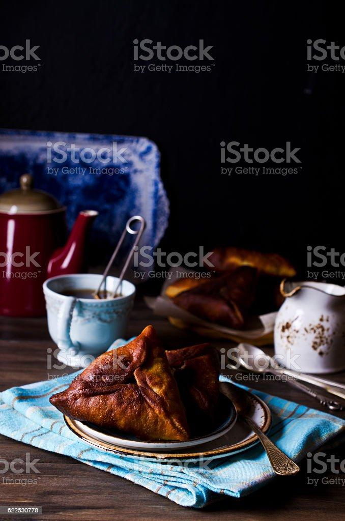 Homemade fried triangular pastry stock photo