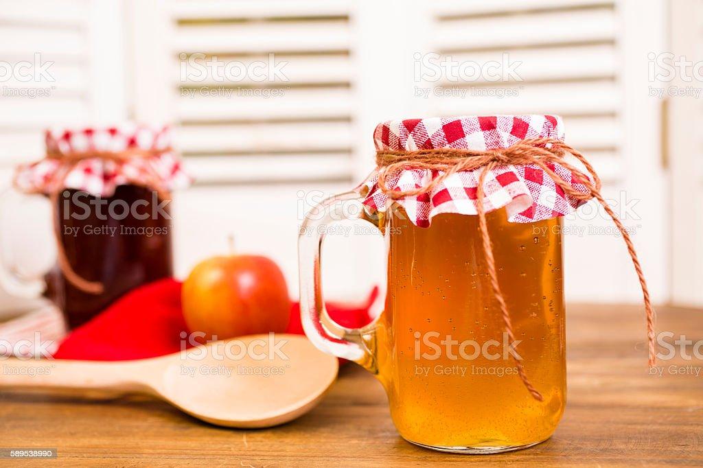 Homemade fruit jam, apple jelly in jars. stock photo