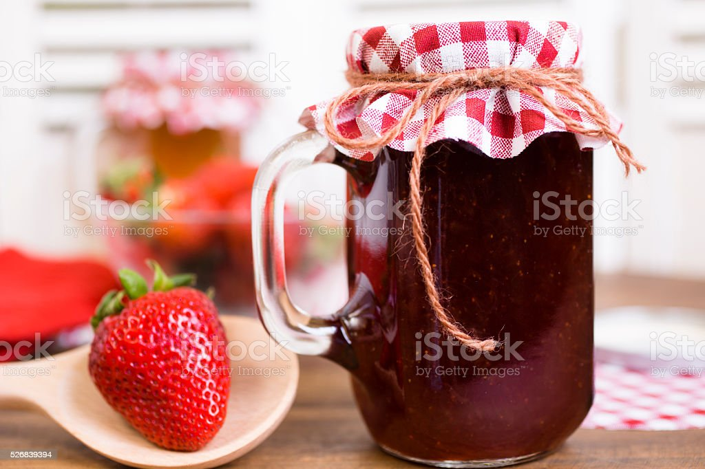 Homemade fruit jam, jelly in jars. Strawberries. stock photo