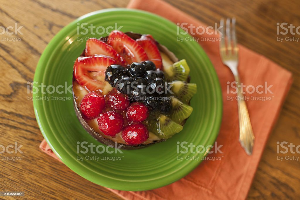 Homemade Fruit Tart with Plate and Fork stock photo