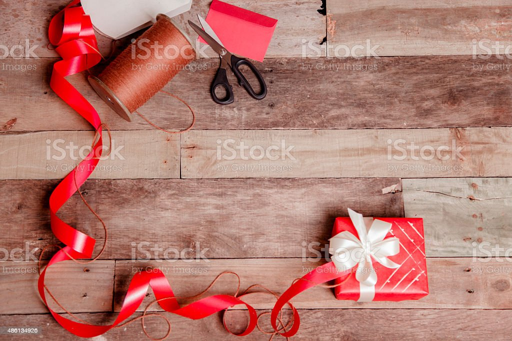 Homemade gift box. Ribbons, twine. Vintage craft. Christmas, Valentine's Day. stock photo