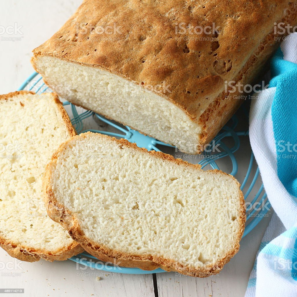 Homemade gluten free bread on blue metal grid stock photo
