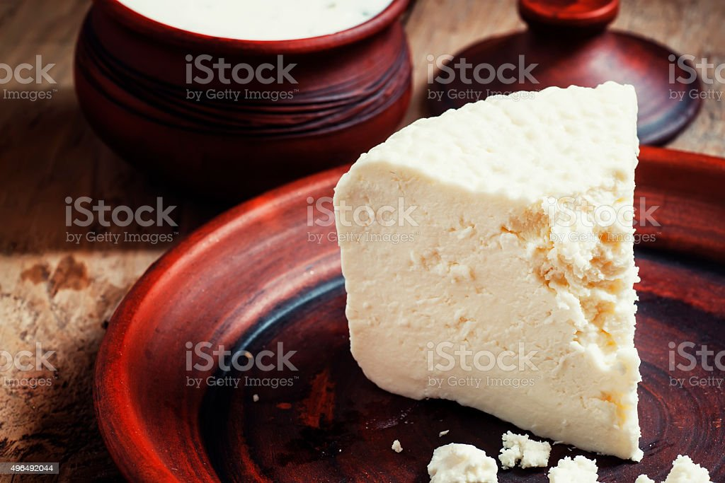 Homemade goat cheese in pottery in the country style stock photo