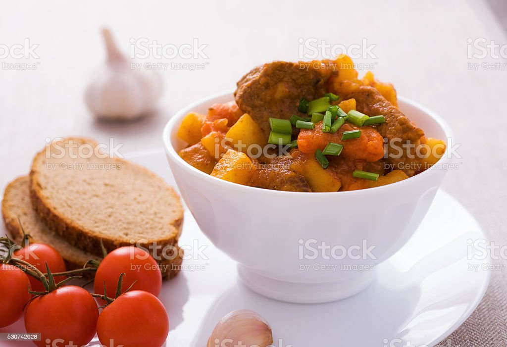Homemade goulash with slices of bread stock photo