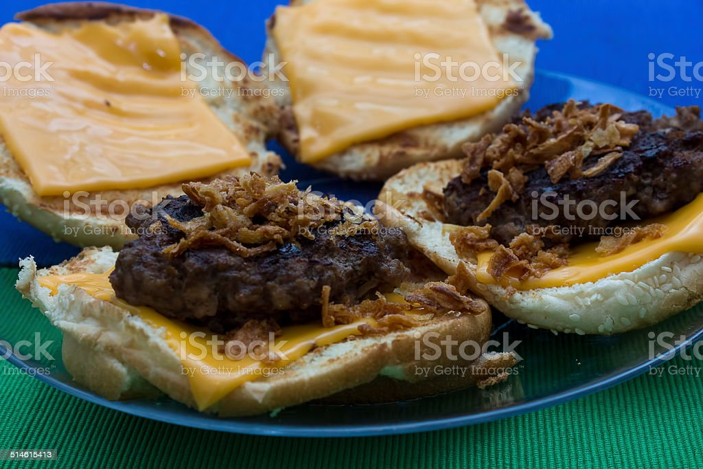Homemade gourmet beef burgers with cheese stock photo