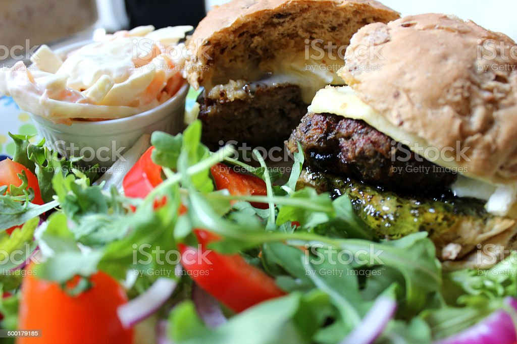Homemade gourmet lamb burger, brie cheese, jelly mint sauce, salad stock photo
