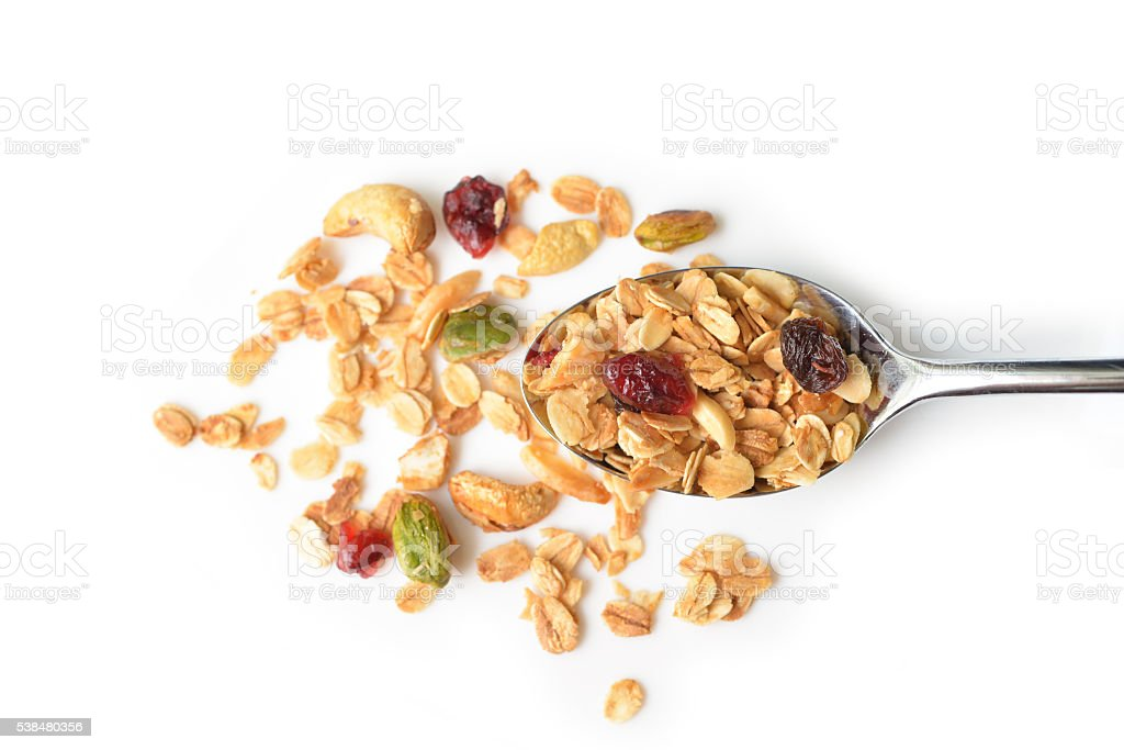Homemade granola in a spoon stock photo
