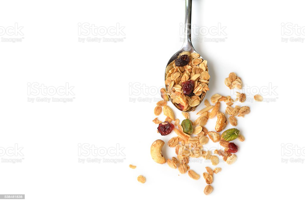 Homemade granola in a spoon stock photo