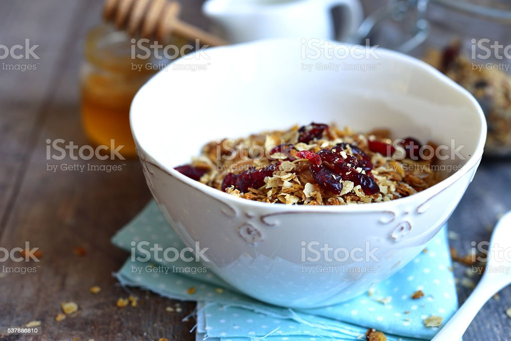 Homemade granola in a white bowl for a breakfast. stock photo