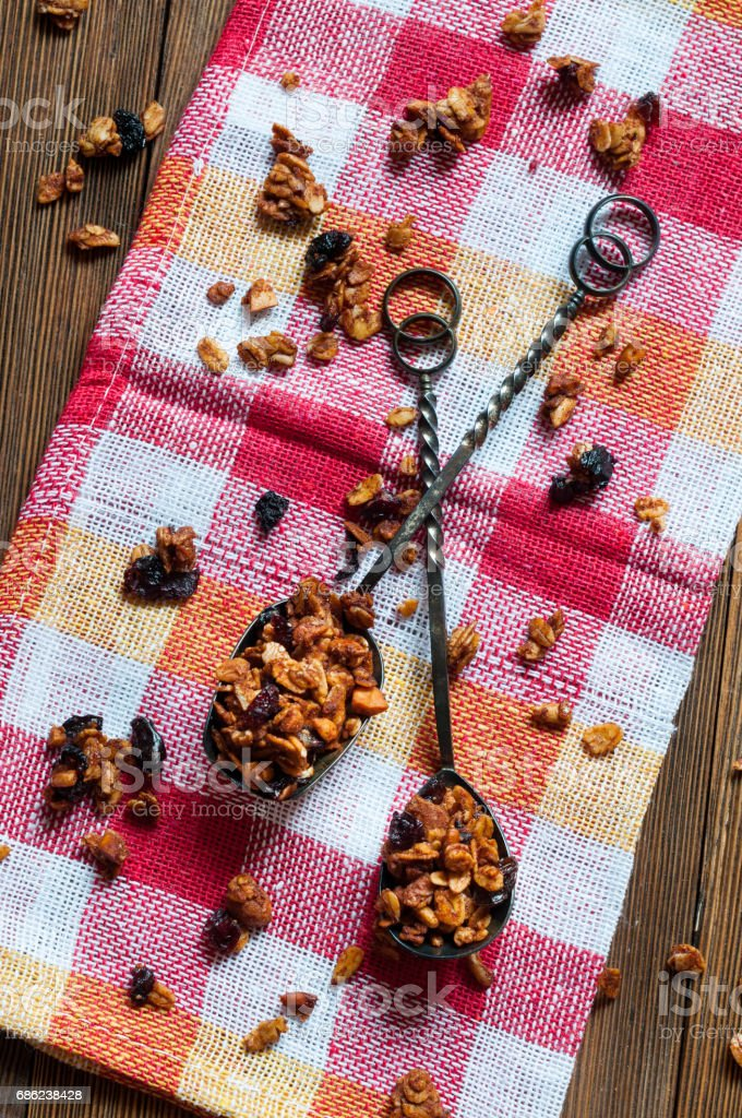 Homemade granola in old vintage spoons stock photo