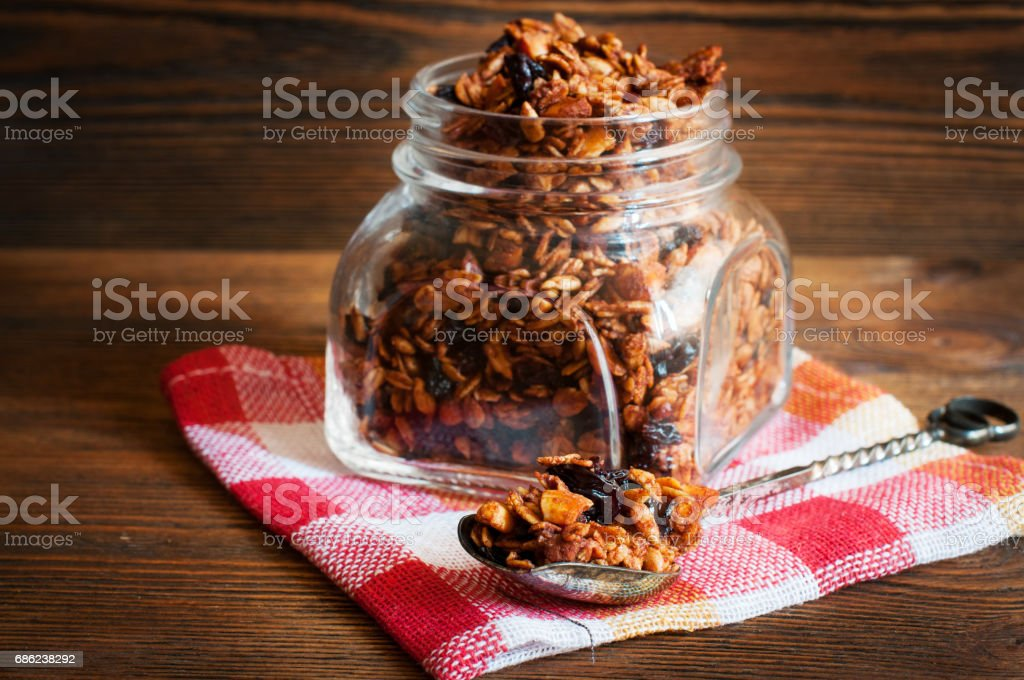 Homemade granola in open glass jar. Selective focus stock photo