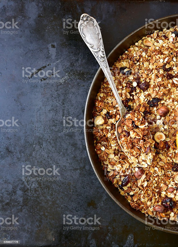 Homemade granola on a black metal tray.Top view. stock photo