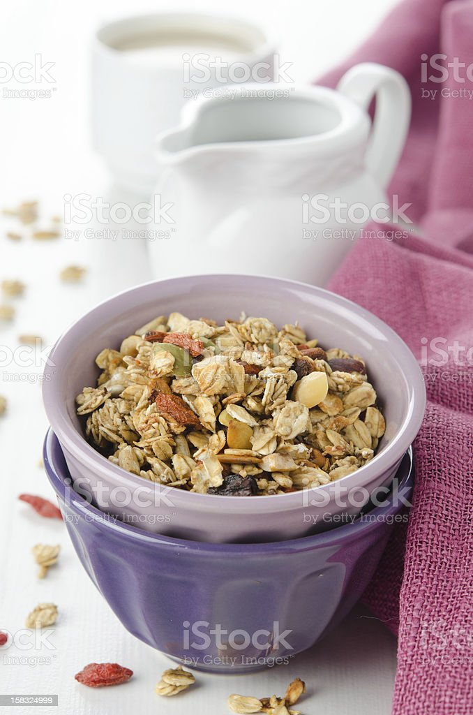 homemade granola with goji berries in a bowl vertical royalty-free stock photo