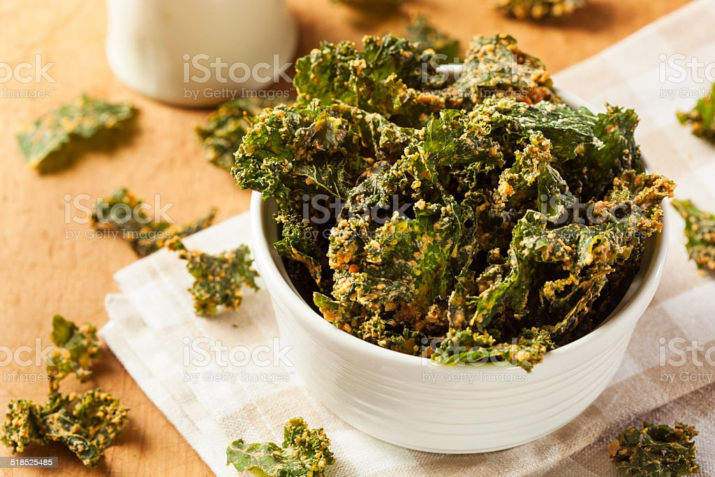 Homemade Green Kale Chips stock photo