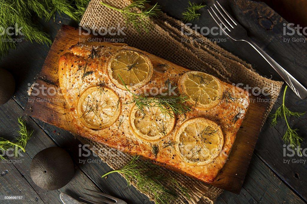 Homemade Grilled Salmon on a Cedar Plank stock photo