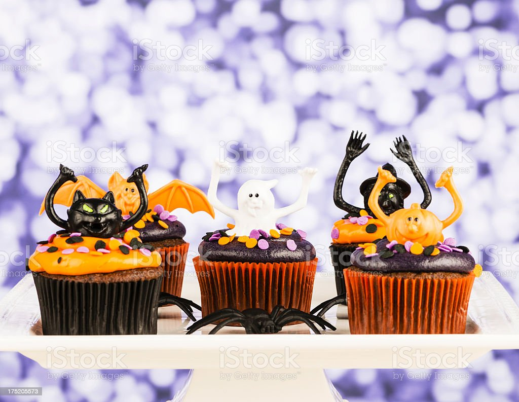 Homemade Halloween Cupcakes with Cute Characters stock photo