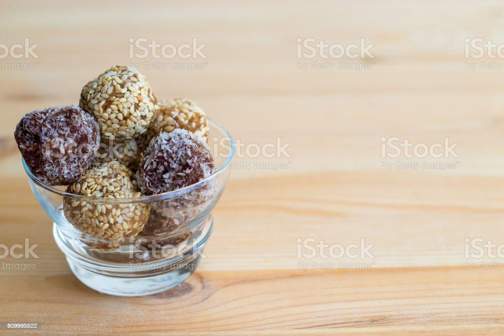 Homemade healthy paleo dates and chocolate energy balls. Vegan truffles. stock photo