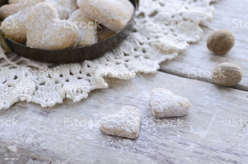Homemade heart shaped cookies on wooden background in vintage style royalty-free stock photo