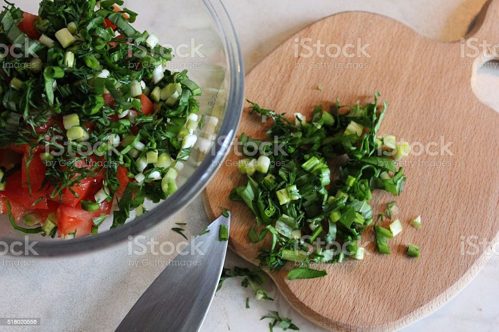 Homemade herb tomato and salad cut on the wooden board stock photo