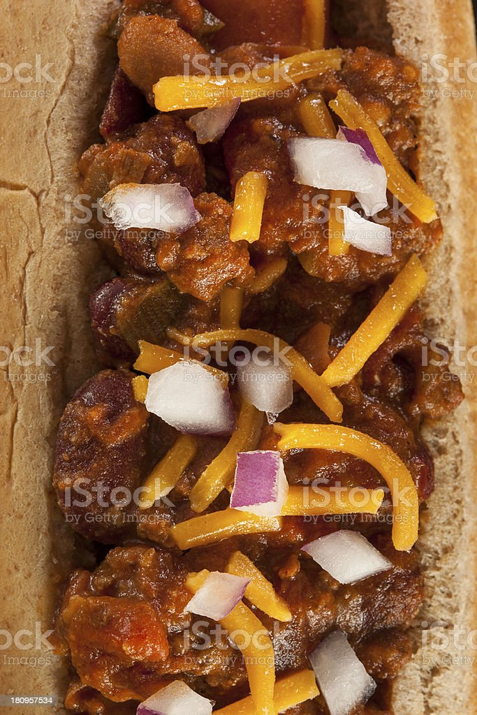 Homemade Hot Chili Dog with Cheddar Cheese royalty-free stock photo