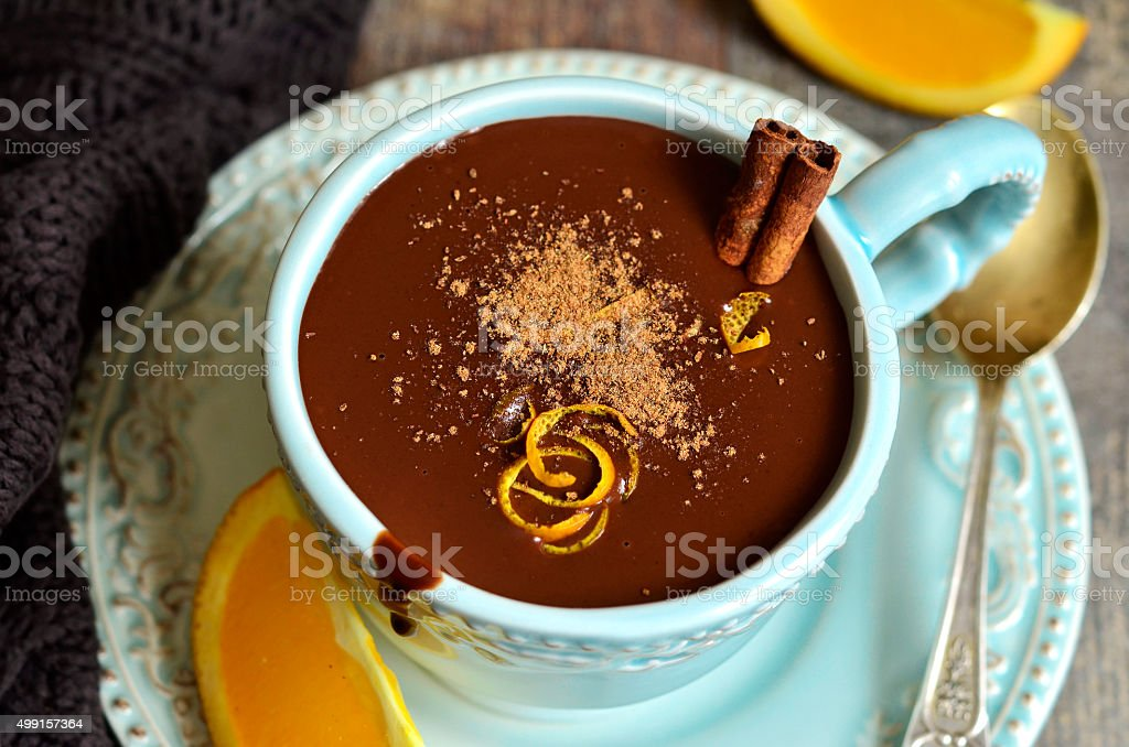 Homemade hot chocolate with orange and cinnamon. stock photo